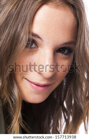 closeup of a pretty blonde young woman - stock photo
