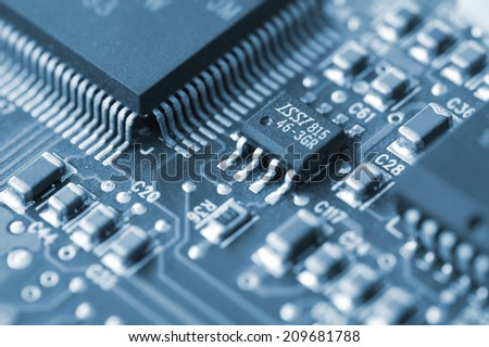 Closeup of a printed circuit board with components such as integrated circuits - stock photo