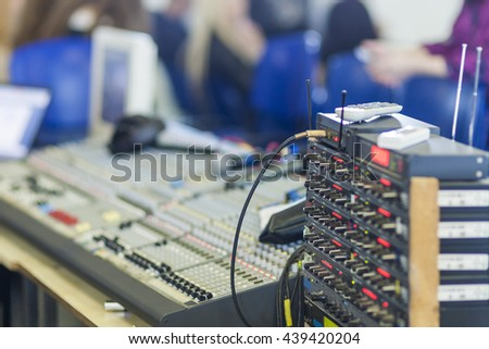 Closeup of a Professional Mixing Console At Work. Horizontal Image Composition