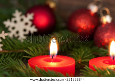 Closeup of a red burning Candle with Christmas Decoration, Winter, Christmas or Advent Background - stock photo