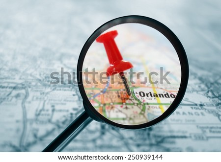 Closeup of a red tack in a map of Orlando Florida                                - stock photo