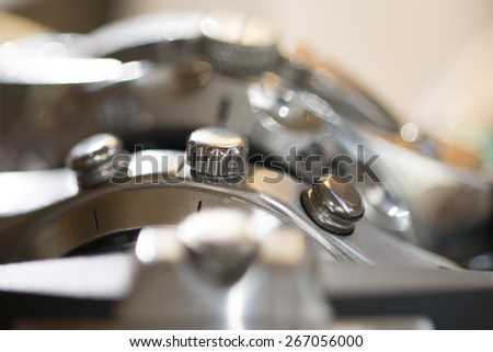 closeup of a roller of winding of a watch - stock photo