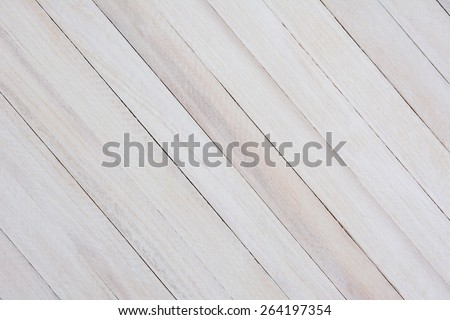 Closeup of a rustic whitewashed wood background. The boards are at an angle. - stock photo