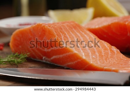 closeup of a salmon fillet on a cutting board