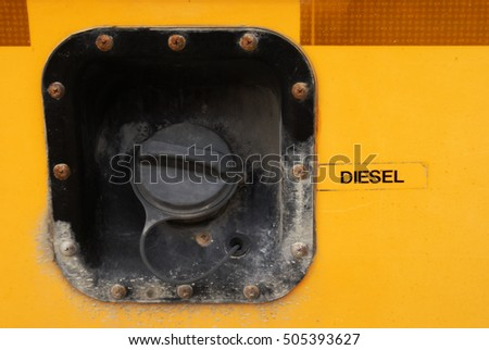 Closeup of a school bus fueling cap.