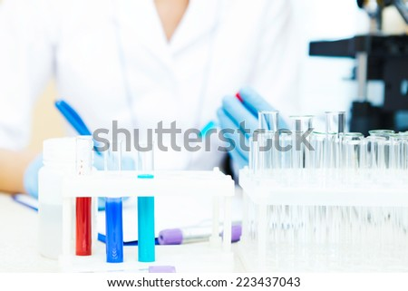 Closeup of a scientist working with samples in lab.