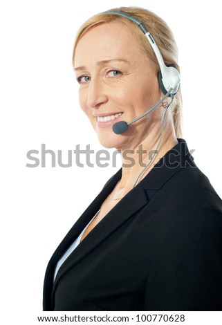 Closeup of a senior telemarketer woman with headsets isolated over white background - stock photo