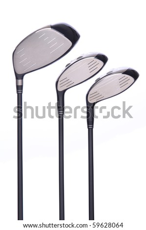 Closeup of a set of three golf metal drivers on a white background.