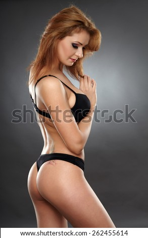 Closeup of a sexy young woman in black lingerie - stock photo