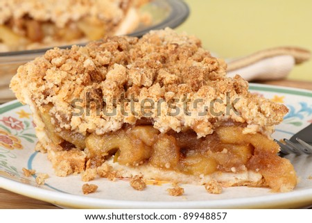 Closeup of a slice of apple crumb pie - stock photo