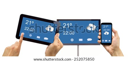 closeup of a smartphone connected to a tv and a tablet through wireless connection in networking - stock photo