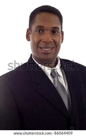 Closeup of a smiling African American businessman isolated over white background
