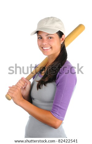 Closeup of a smiling female softball player holding a wooden bat on her shoulder. Vertical format isolated on white.