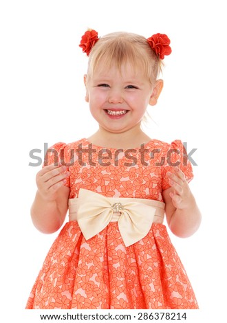 Closeup of a smiling little girl in a lush orange dress-Isolated on white background - stock photo