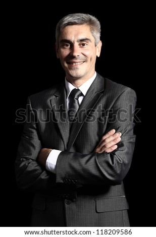 Closeup of a smiling senior man isolated over black background
