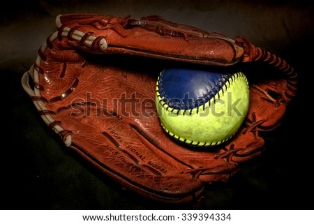 Closeup of a Softball Glove and ball