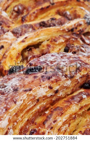 closeup of a spanish Trenza de Almudevar, a typical braided pastry, on a white background - stock photo