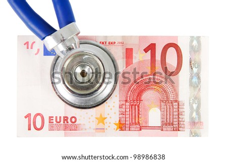 Closeup of a stethoscope on a banknote over a white background - stock photo