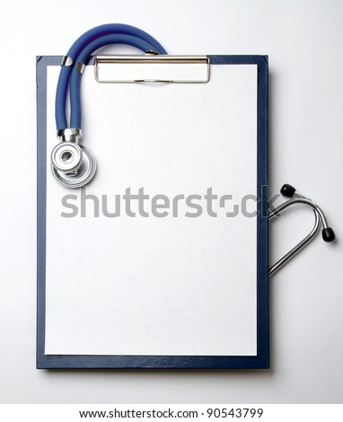 Closeup of a stethoscope on a rx prescription isolated on white background - stock photo