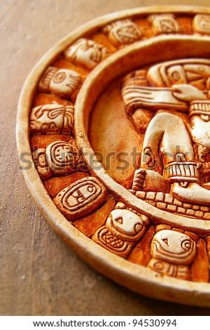 closeup of a stone carved Mayan calendar - stock photo