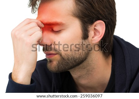 Closeup of a stressed handsome young man over white background