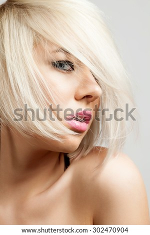 Closeup of a stylish blonde woman with short hair - stock photo