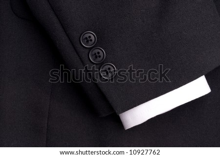 closeup of a suit sleeve with a white cuff - stock photo