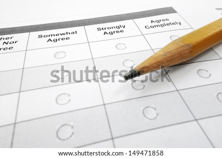 closeup of a survey questionnaire form and pencil                                - stock photo