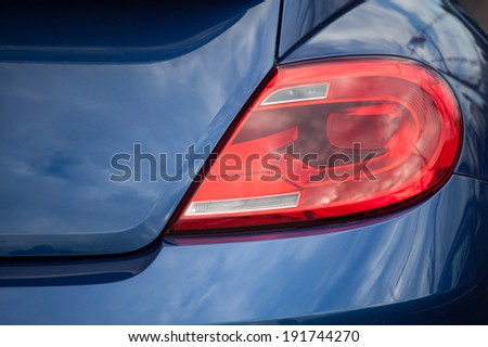 Closeup of a taillight on a modern car - stock photo