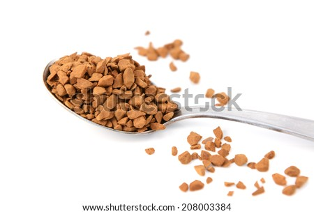 Closeup of a teaspoon of instant coffee granules, isolated on a white background - stock photo