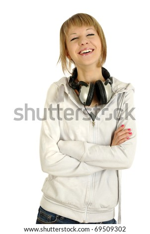 Closeup of a teen girl with headphones standing against isolated white background - stock photo