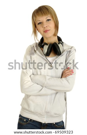 Closeup of a teen girl with headphones standing against isolated white background