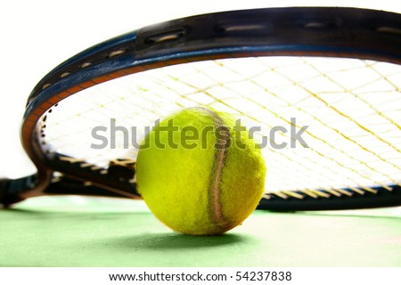 closeup of a tennis racket and tennis-ball