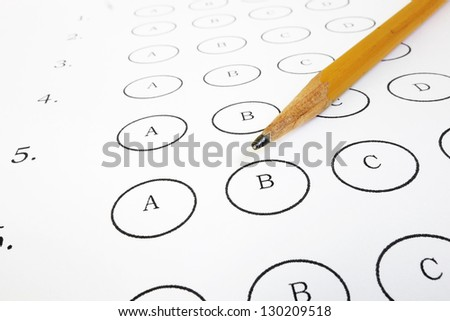 Closeup of a test answer sheet and pencil - stock photo