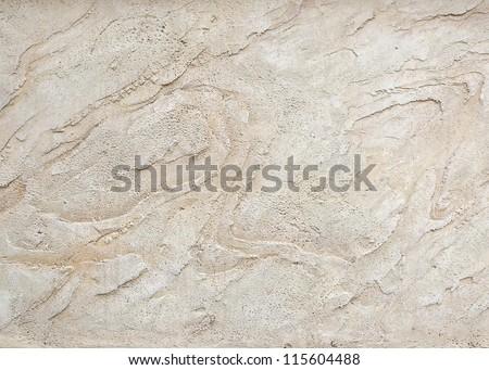 Closeup of a textured concrete decorative surface - stock photo