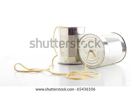closeup of a tin cans phone isolated on white background, communication concept - stock photo