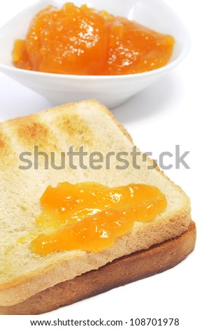 closeup of a toast with jam on a white background