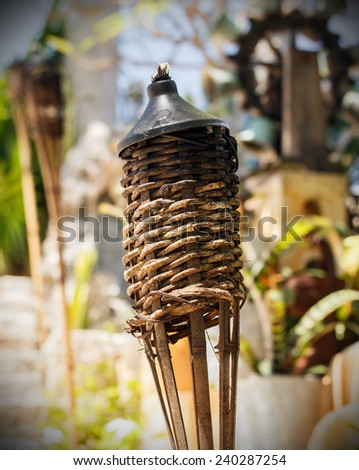 Closeup of a torch on colorful Mexican graveyard near Playa del Carmen - stock photo