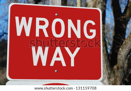 "closeup of a traffic sign reading ""Wrong Way"" - stock photo"