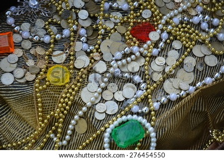 Closeup of a treasure with coins, jewels and chains. - stock photo