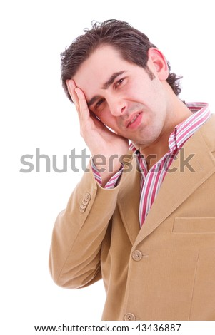 Closeup of a troubled young business man, whith a headache, isolated on white backgound - stock photo
