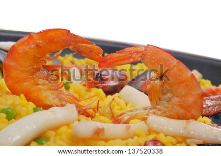 closeup of a typical paella from Spain on a white background
