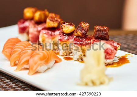Closeup of a variety of sushi on a plate with selective focus - stock photo
