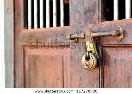 Closeup of a vintage door with lock - stock photo
