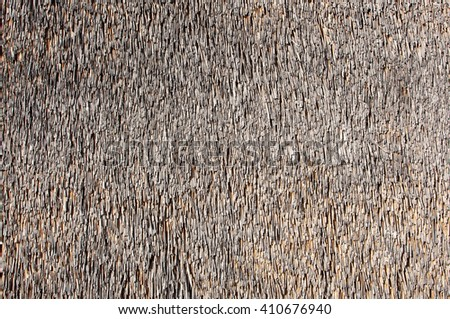 Closeup of a wall made of reed as background. - stock photo