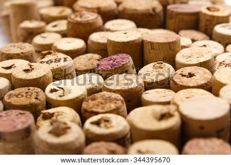 Closeup of a wall of used wine corks. A random selection of used wine corks, some with vintage years. - stock photo