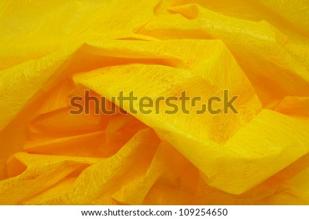 closeup of a wavy yellow wrapping fabric