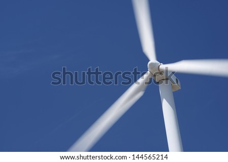 closeup of a windmill for renewable electric energy production - stock photo