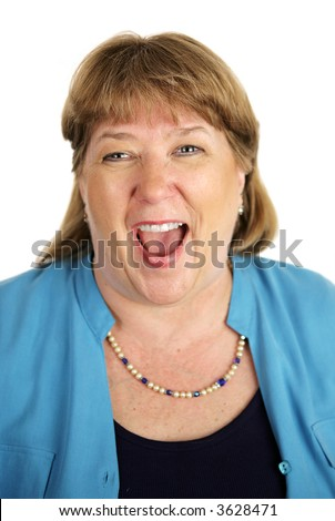 Closeup of a woman laughing hysterically.  Isolated on white.