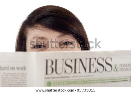Closeup of a woman reading a business newspaper isolated over white background - stock photo